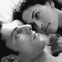 black and white man and woman in bed